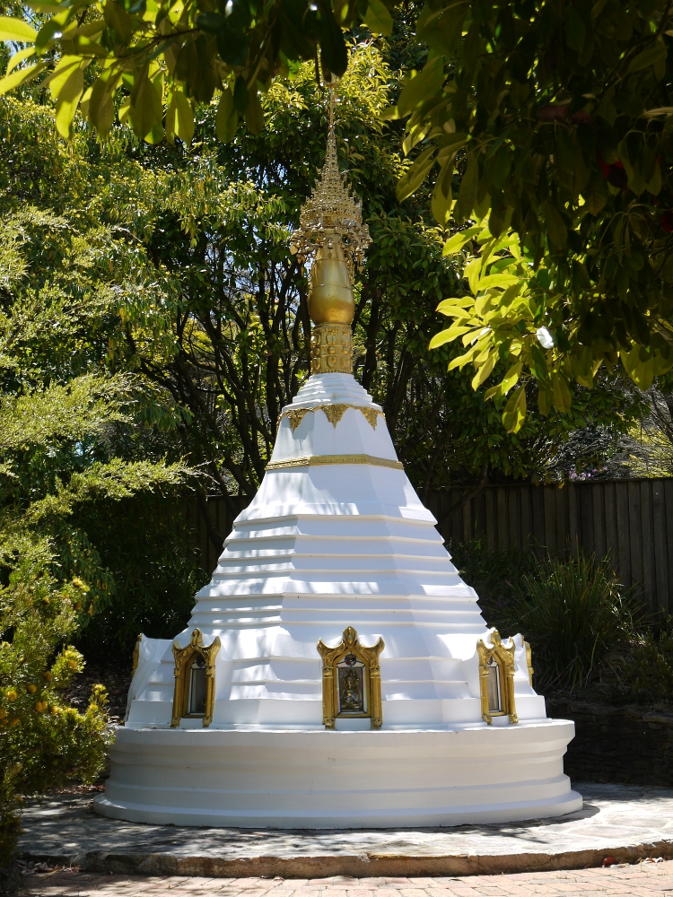 bmimc-stupa-through-trees